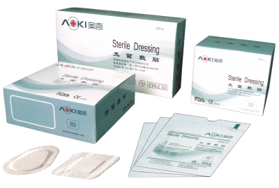 Adhesive non-woven wound dressing